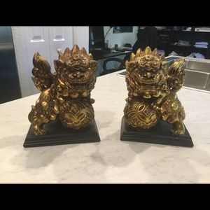 Two gold foo dog statues